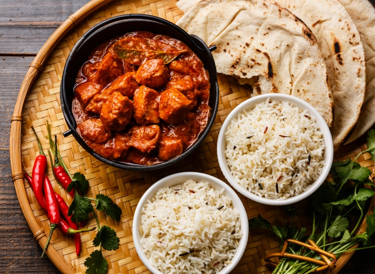 Chicken tikka masala spicy curry meat food in cast iron pot with